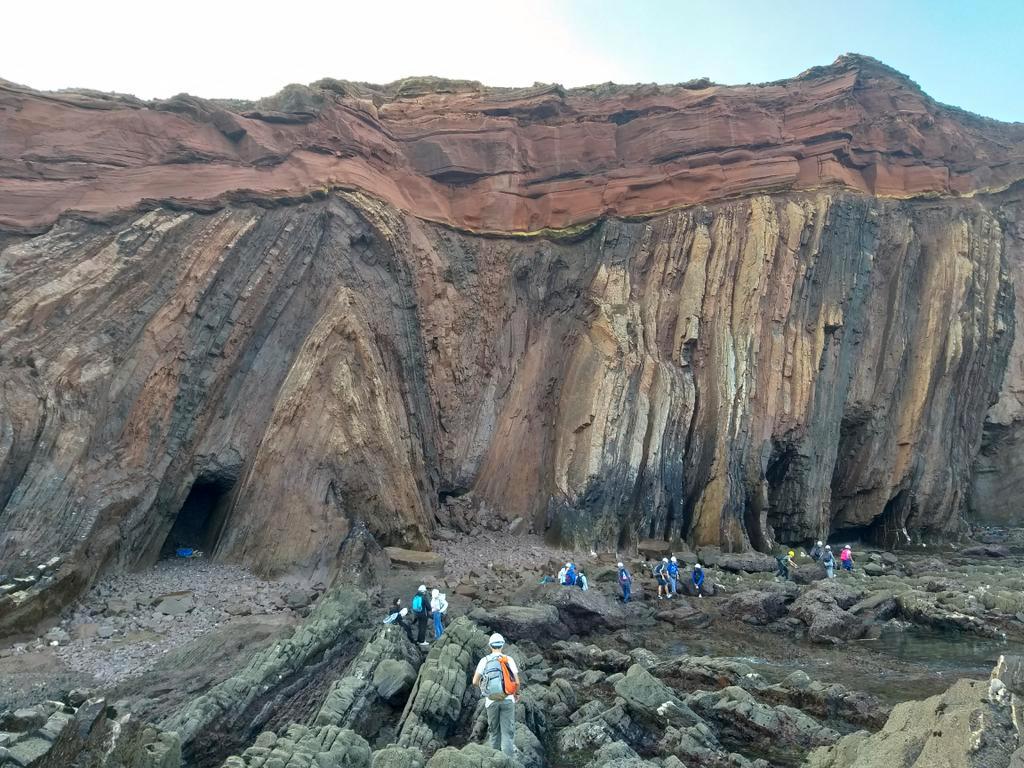 Angular unconformity, Telheiro Beach, Portugal, showing Triassic sandstone atop folded, eroded, Carboniferous graywacke and shale. Photo by Joao Duarte, 2019.