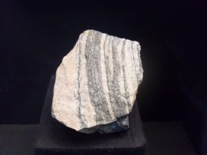 A fragment of the Acasta Gneiss, the oldest known rock on our planet. In exhibition at the Natural History Museum in Vienna. By Pedroalexandrade on Wikimedia. CC BY-SA 3.0