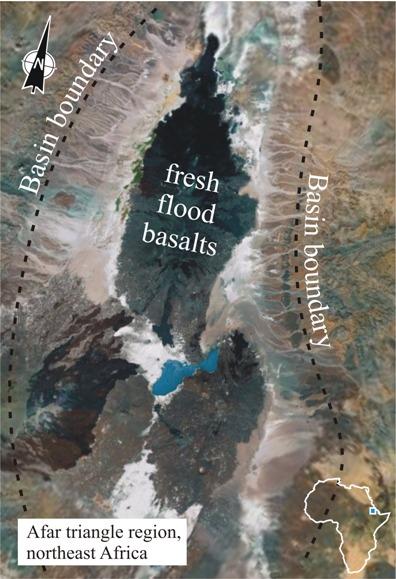 Annotated satellite photo of the Afar Triangle region of northeast Africa. Alluvial fans descend from the basin boundary into the low-lying central area. There are also lakes down there, and vast white salt flats. There are also five major blotches of jet-black flood basalts.