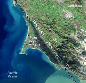 Satellite view of coastal California and the eastern Pacific Ocean, showing a linear bay and valley between the Point Reyes Peninsula and the rest of California.