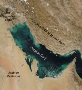 Satellite photograph of the Persian Gulf and Zagros Mountains. North is at the top of the image; a portion of the Arabian Peninsula is in the lower left. The Mesopotamian rivers Tigris and Euphrates flow in from the upper left (northwest) corner. Both the Persian Gulf and the Zagros Mountains trend northwest to southeast across the field of view.