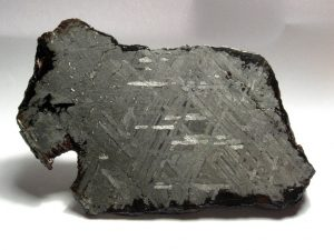 The meteorite is polished showing the Widmanstätten Pattern.