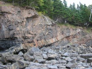 Igneous sill intruding in between Paleozoic strata in Nova Scotia