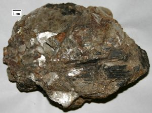 Pegmatic texture with large grains of minerals, mostly of felsic composition