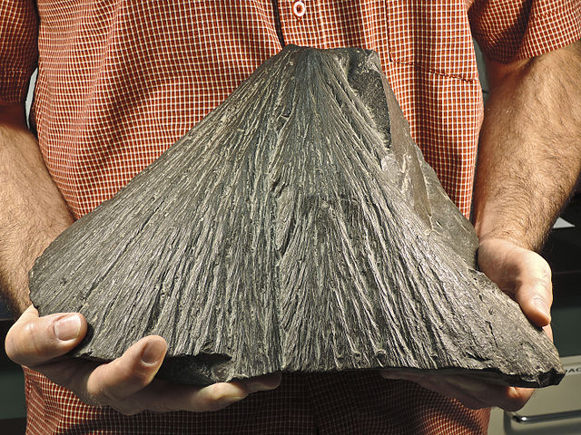 Shatter cones are cone-shaped features, that show lines that converge to cone shapes.
