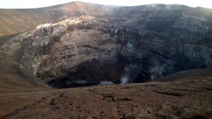 The crater has white rocks in the walls