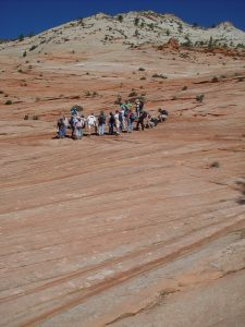 The students are on the red rock