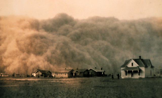 The black and white photo shows a giant wall of dust.