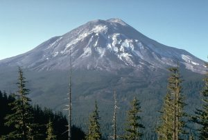 The volcano is conical and forested.