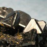 The dark brown mineral is triangular