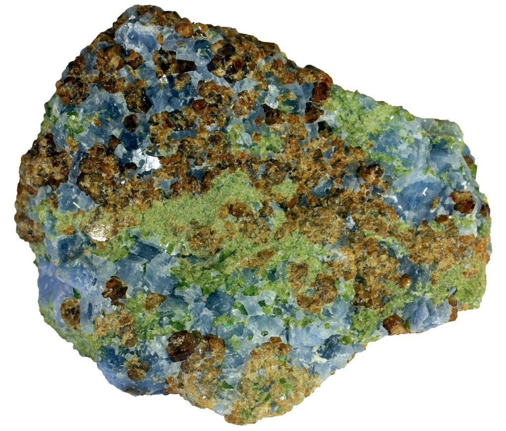 Calcite is blue, augite green, and garnet brown/orange in this rock.