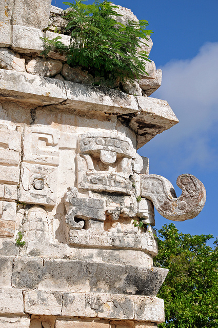 Mayan stone figure with a long elephant-like nose representing a water deity.