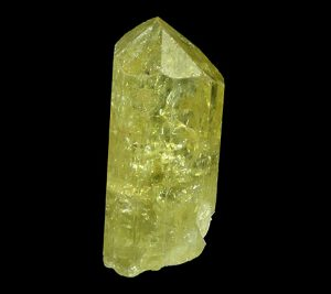 The crystal is hexagonal and light green.