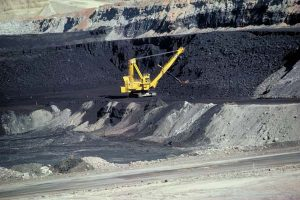 A large machine is removing coal.