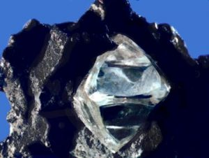 The diamond is clear and pyramidal.
