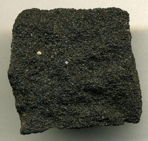 The sandstone is black with tar.