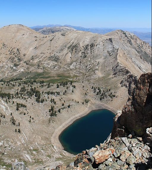 A mountainous area with a circular bowl filled with a lake.
