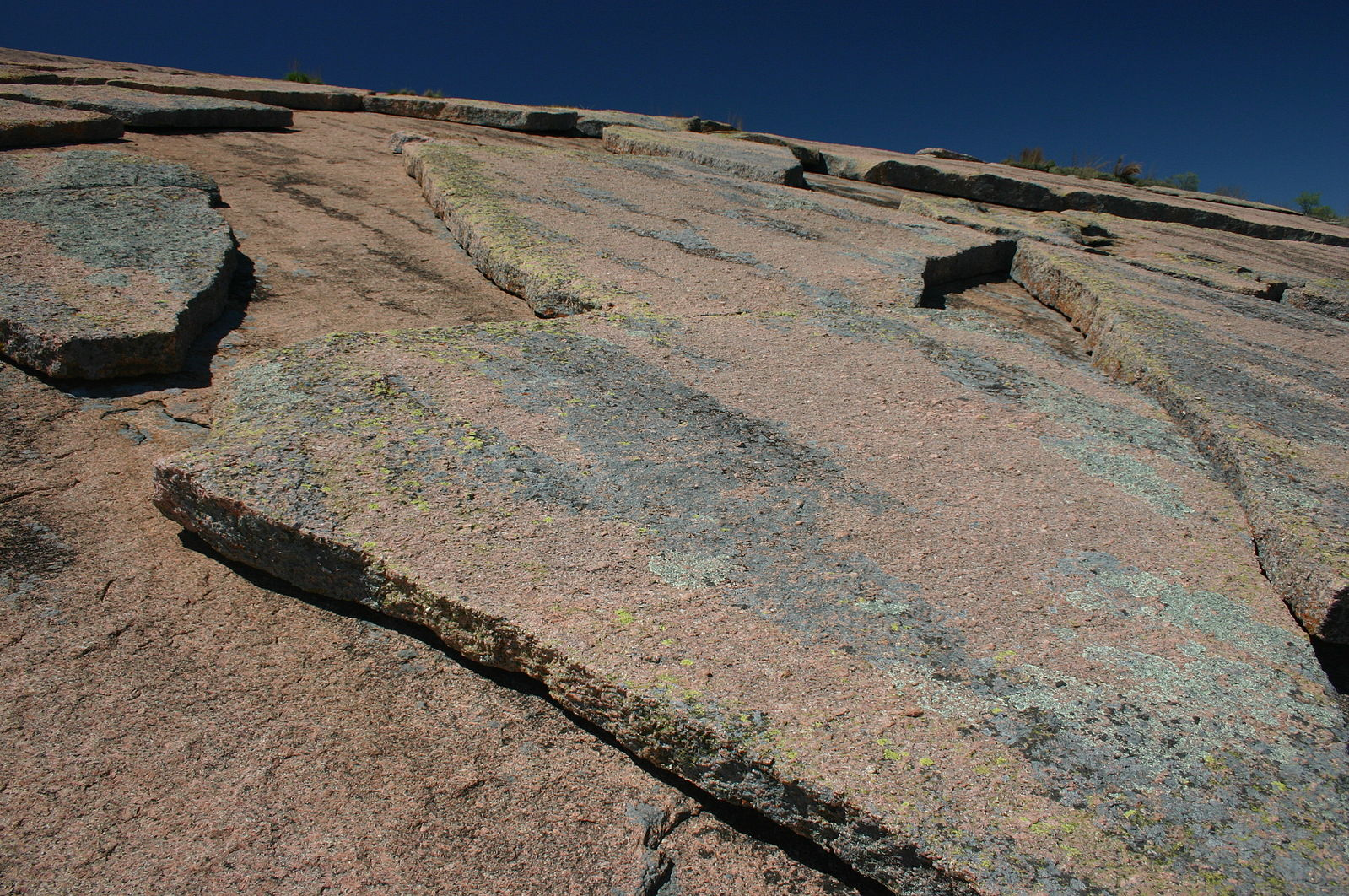 Granite rock has a relatively thin layer that is peeling away