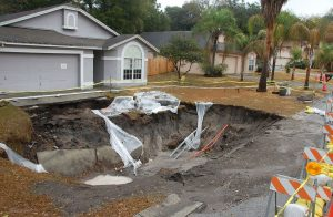 Sinkhole that appeared in Florida in the front yard of a home.