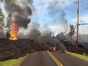 Lava from Kiluea destroying road in Hawaii.